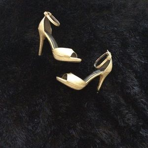 Michael Antonio Gold Heels